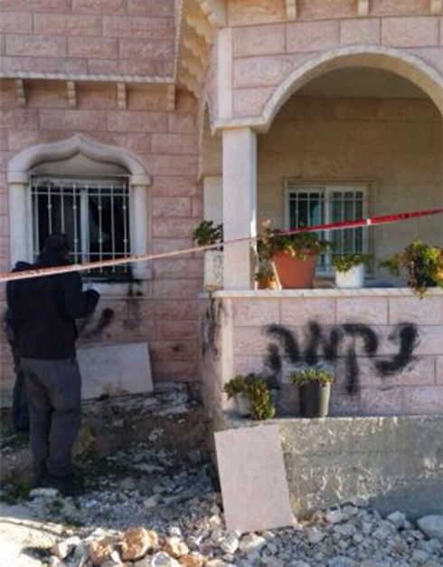 Palestinian home in Khirbat Adirat set on fire with 'revenge' sprayed on outside wall.