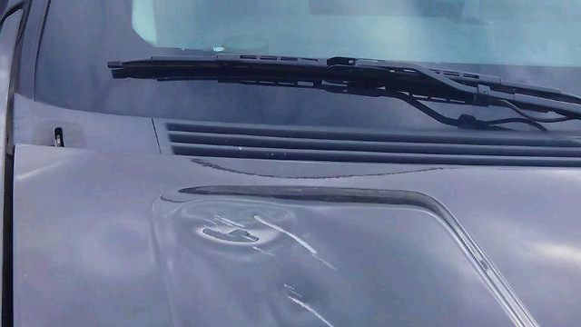 Damage to US cars (Photo: Zachriya Sade, Rabbis for Human Rights)