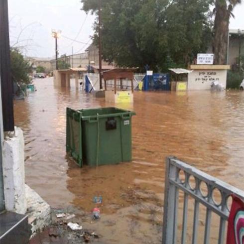 Flooded entrance to Zrifin army base
