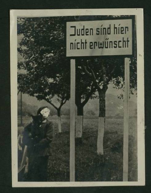 Jews are not welcome here, written on a sign in a wooded area (Photo courtesy of the National Library)