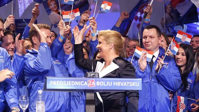 """""""יש לנו עבודה קשה"""". חגיגת הניצחון של קיטרוביץ' (צילום: EPA) (צילום: EPA)"""