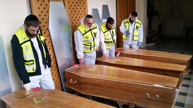 Coffins of four Paris kosher mart victims (Photo: EPA)