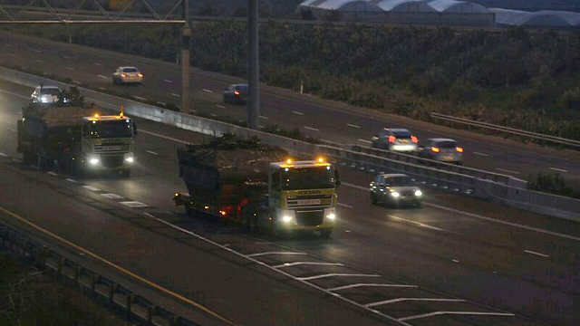 Military vehicles travel north (Photo: George Ginsburg)