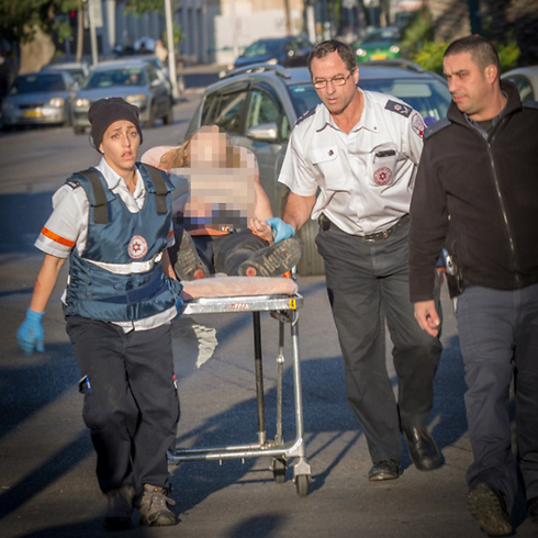 Rescue personnel rush a wounded man from the site of the attack. (Photo: Magen David Adom) (Photo: Magen David Adom)