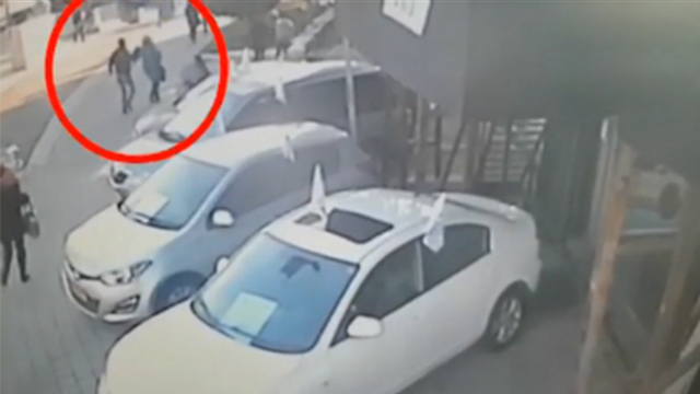Terrorist on the run. Why is he stabbing a woman who might be Muslim herself? (Photo courtesy of Channel 10)