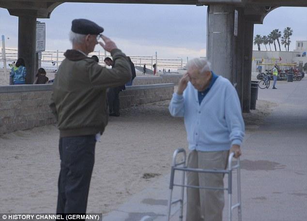 Holocaust survivor Joshua Kaufman salutes Daniel Gillepsie, the man who rescued him from Dachau