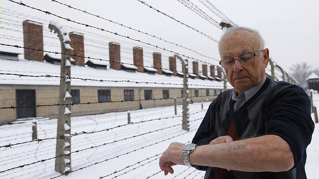 Survivor Jack Rosenthal from the US displays his prisoner number (Photo: Reuters)