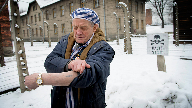 A Holocaust survivor showing his number tattoo (Photo: MCT)