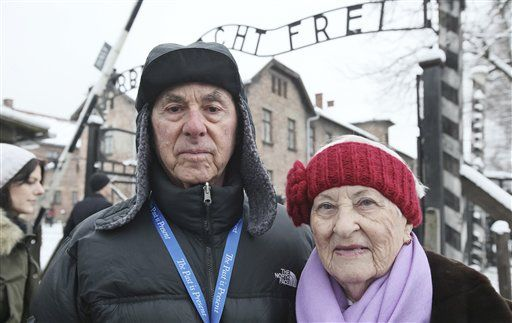 Rose Schindler, 85, right, survivor of Auschwitz, and husband Max, 85, visit former death camp day before major ceremonies marking 70th anniversary of camp's liberation (Photo: Associated Press) (Photo: Associated Press)