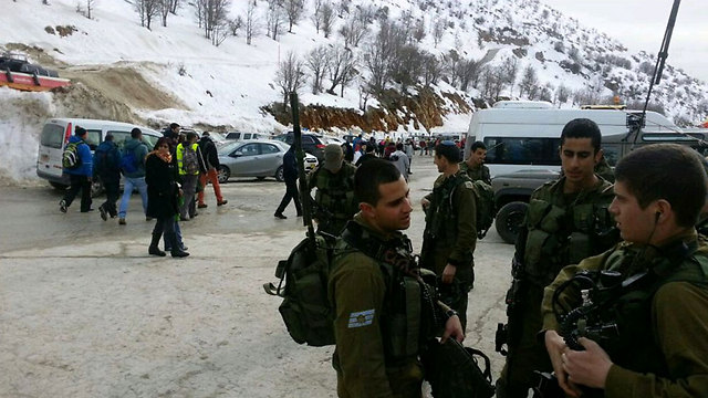 IDF soldiers evacuating visitors from Hermon ski site.