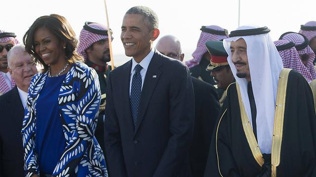 Michelle and Barack Obama with Saudi King Salman on a visit to Saudi Arabia (Photo: AFP)