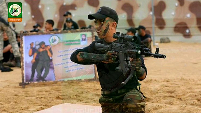 Palestinian teen with modified rifle