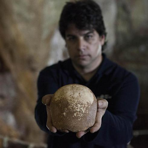 Dr. Omry Barzilai holds ancient skull found inside cave (Photo: AP)  (Photo: AP)