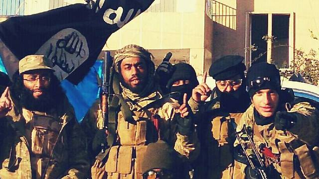 Mohammed Emwazi with ISIS fighters (Photo: Facebook)