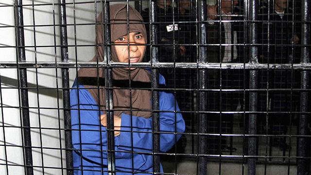 Iraqi Sajida al-Rishawi, 35, stands inside a military court at Juwaida prison in Amman (Photo: MCT) (Photo: MCT)
