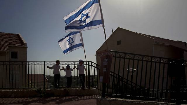 Israeli flags over Beit El (Photo: AP) (Photo: AP)