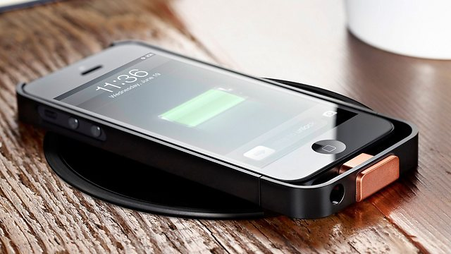 IPhone charging on a Powermat (Photo: AP)