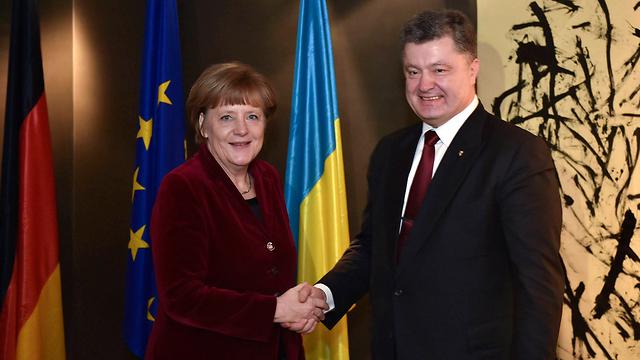 קנצלרית גרמניה אנגלה מרקל ונשיא אוקראינה פטרו פורושנקו (צילום: MCT)