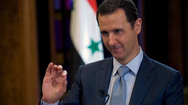 אסד. יפנה את השטח לאיראנים? (צילום: AFP PHOTO / HO / SANA) (צילום: AFP PHOTO / HO / SANA)