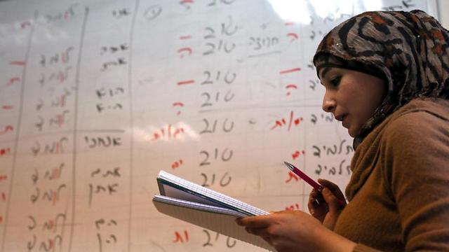 A Palestinian student looks at a notepad during a Hebrew language course at the Nasser al-Shiukhi college in Ramallah (Photo: AFP) (Photo: AFP)