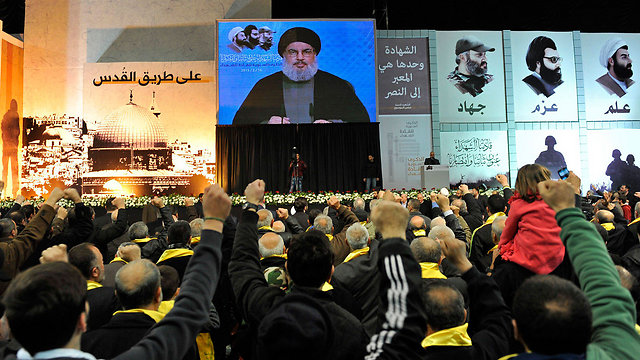 Crowd watching Nasrallah's speech (Photo: EPA)