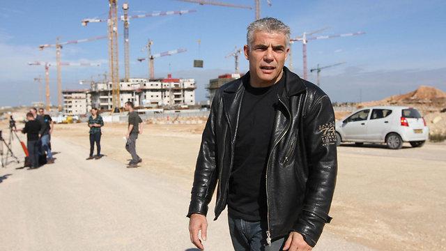 Lapid says housing report will show Likud's neglect of housing. (Photo: Ido Erez)
