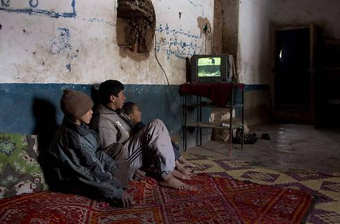 בכפר הסמוך החיים קצת שונים (צילום: רויטרס) (צילום: רויטרס)