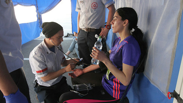 Runner treated at first-aid tent (Photo: Ido Erez) (Photo: Ido Erez)