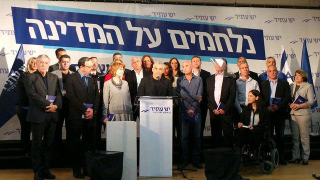 Yesh Atid present its campaign platform.