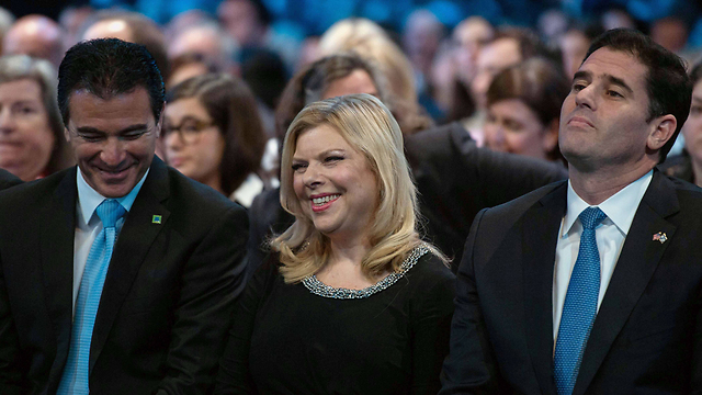 Sara Netanyahu and Ron Dermer (R). it wouldn't have done the prime minister any harm to shower Obama and his administration with a few more compliments too (Photo: AFP)