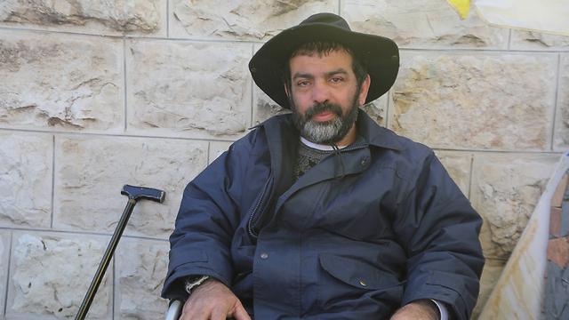 עמאר מוחה בירושלים (צילום: גיל יוחנן) (צילום: גיל יוחנן)