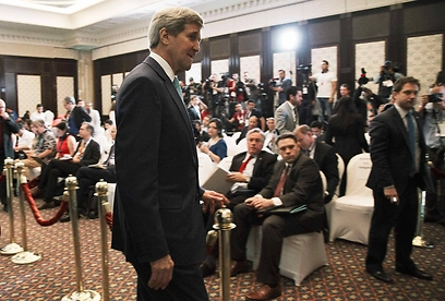 Kerry in Egypt. Washington didn't set an ultimatum to al-Sisi: Either invite the Israelis or we won't come (Photo: Reuters)