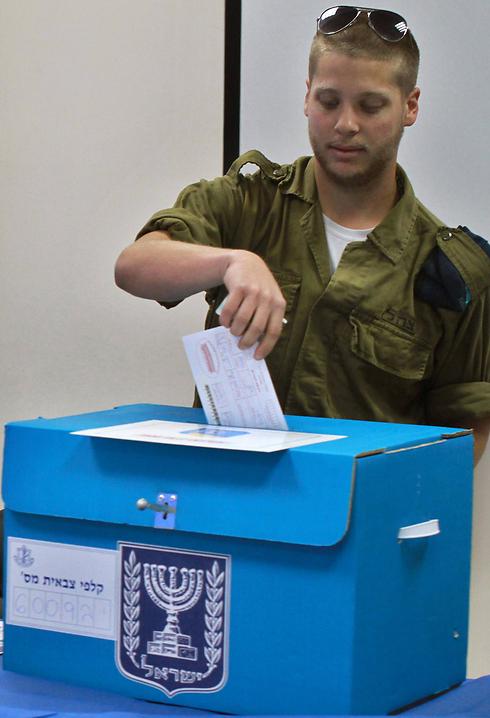 IDF soldier votes at base. (Photo: AFP)