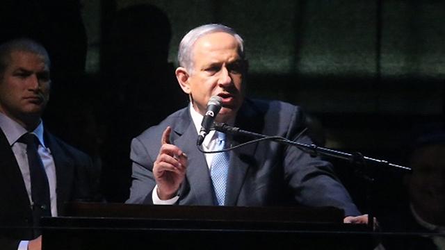 Netanyahu speaking at the rally (Photo: Motti Kimchi)