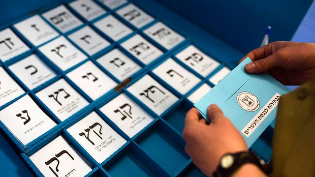 קלפי בבחירות לכנסת ה-20 (צילום: רויטרס) (צילום: רויטרס)