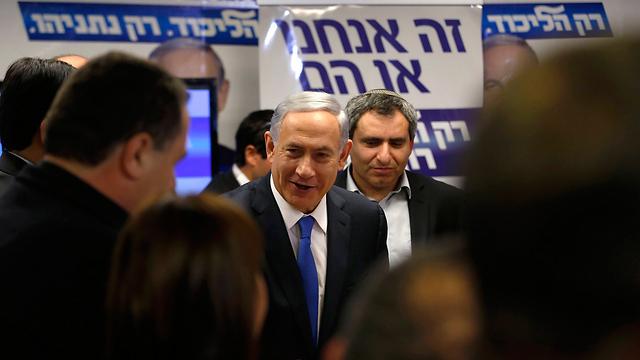 """It's us or them"" Likud solgan reads (Photo: Reuters)"