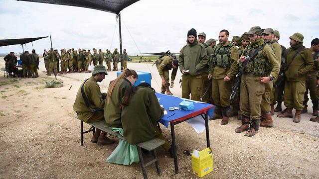 IDF soldiers wait in line to vote. (Photo: IDF Spokesman's Unit)