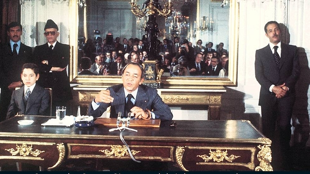 Morocco's King Hassan II (center) and  lieutenant Ahmad Dlimi to the right.