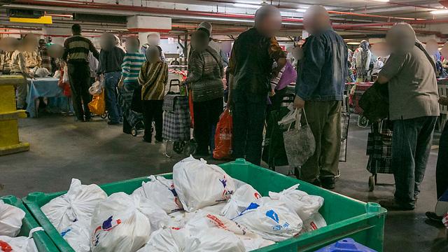 חלוקת מזון בעמותת פתחון לב. ארכיון (צילום: עידו ארז) (צילום: עידו ארז)