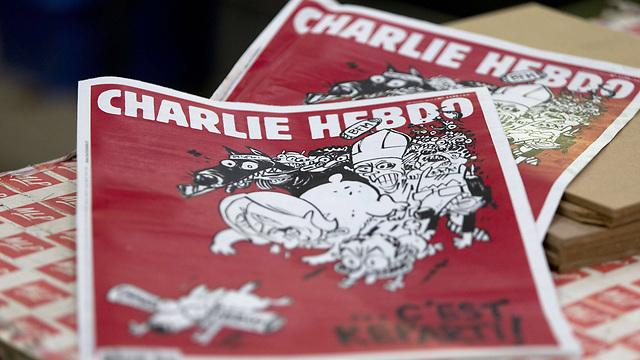 """לא השתיקו אותם. הגיליון האחרון של """"שארלי הבדו"""" (צילום: AFP) (צילום: AFP)"""
