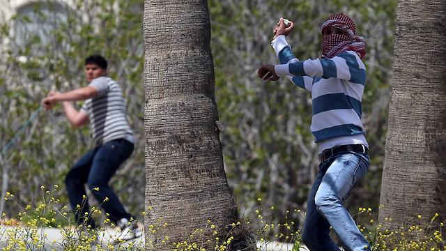 Stone throwers in Silwan (Photo: AFP)