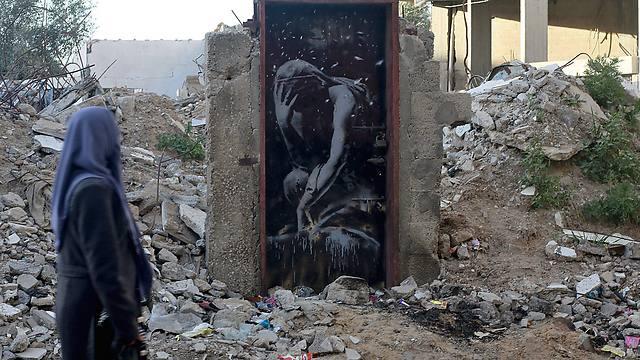 The door with Banksy's art (Photo: EPA)