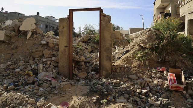 The empty door frame, left after the sale of the door itself (Photo: AP)