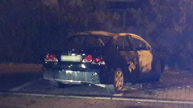 """הרכב של המתנקש והמסיע בזירת הרצח הכפול (צילום: אחיה ראב""""ד) (צילום: אחיה ראב"""