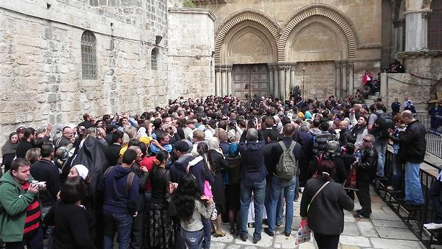 Christian pilgrims outside the Church of the Holy Sepulcher on Holy Saturday (Photo: Ziv Reinstein)