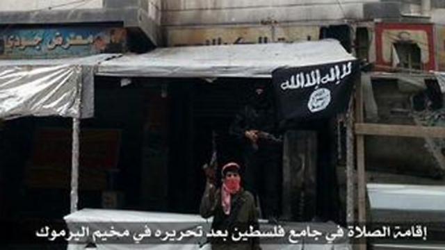 Islamic State flag flies in Yarmouk