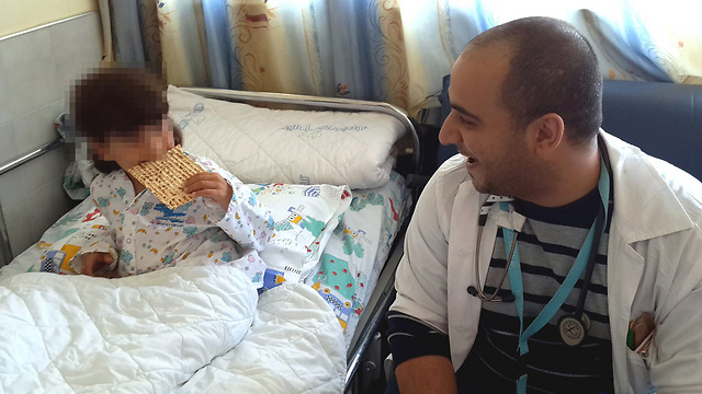 The boy munching on his new favorite food (Photo: Ziv Medical Center)