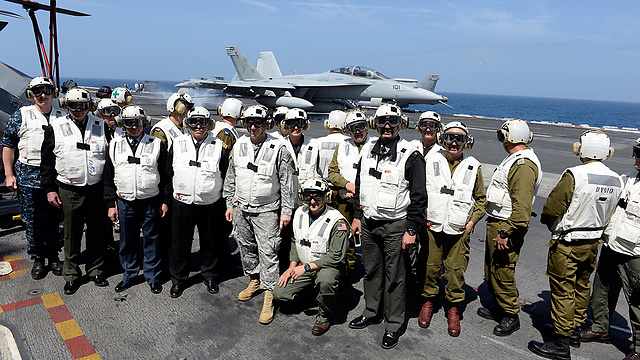 IDF offiers pose for picture with US Navy personnel.