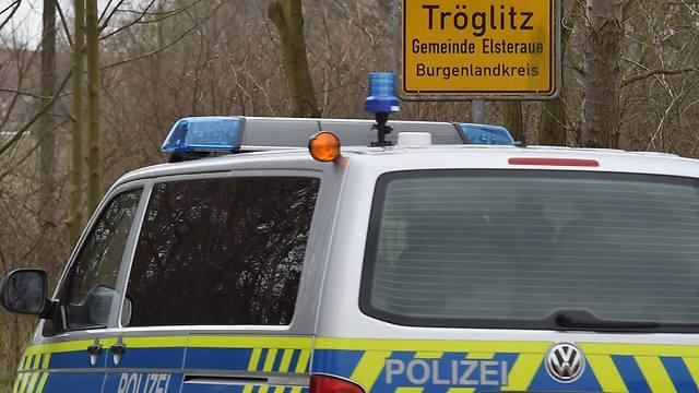 A police car enters the municipality Troeglitz, Germany (Photo: EPA)
