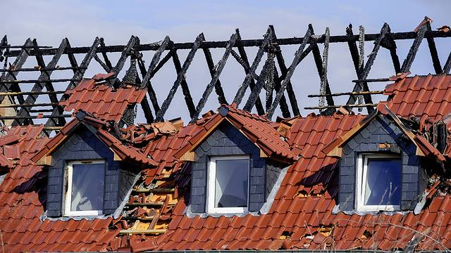 A facility for housing refugees, which was destroyed by an arson attack, in Troeglitz, Germany (Photo: Getty Images)
